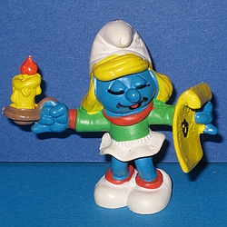 Christmas smurfette with candle